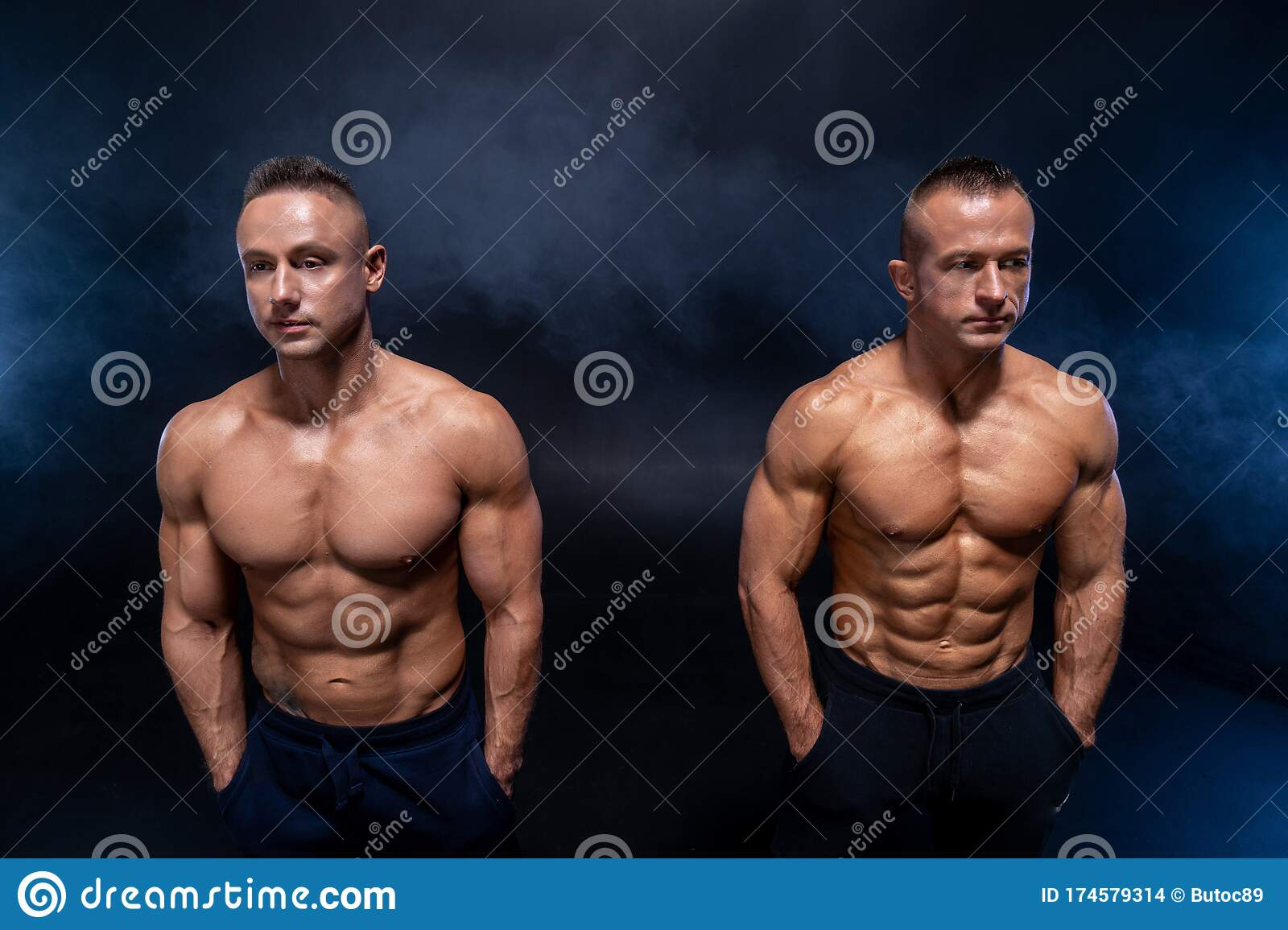 Two Muscular Man On The Black Background. Strong Male