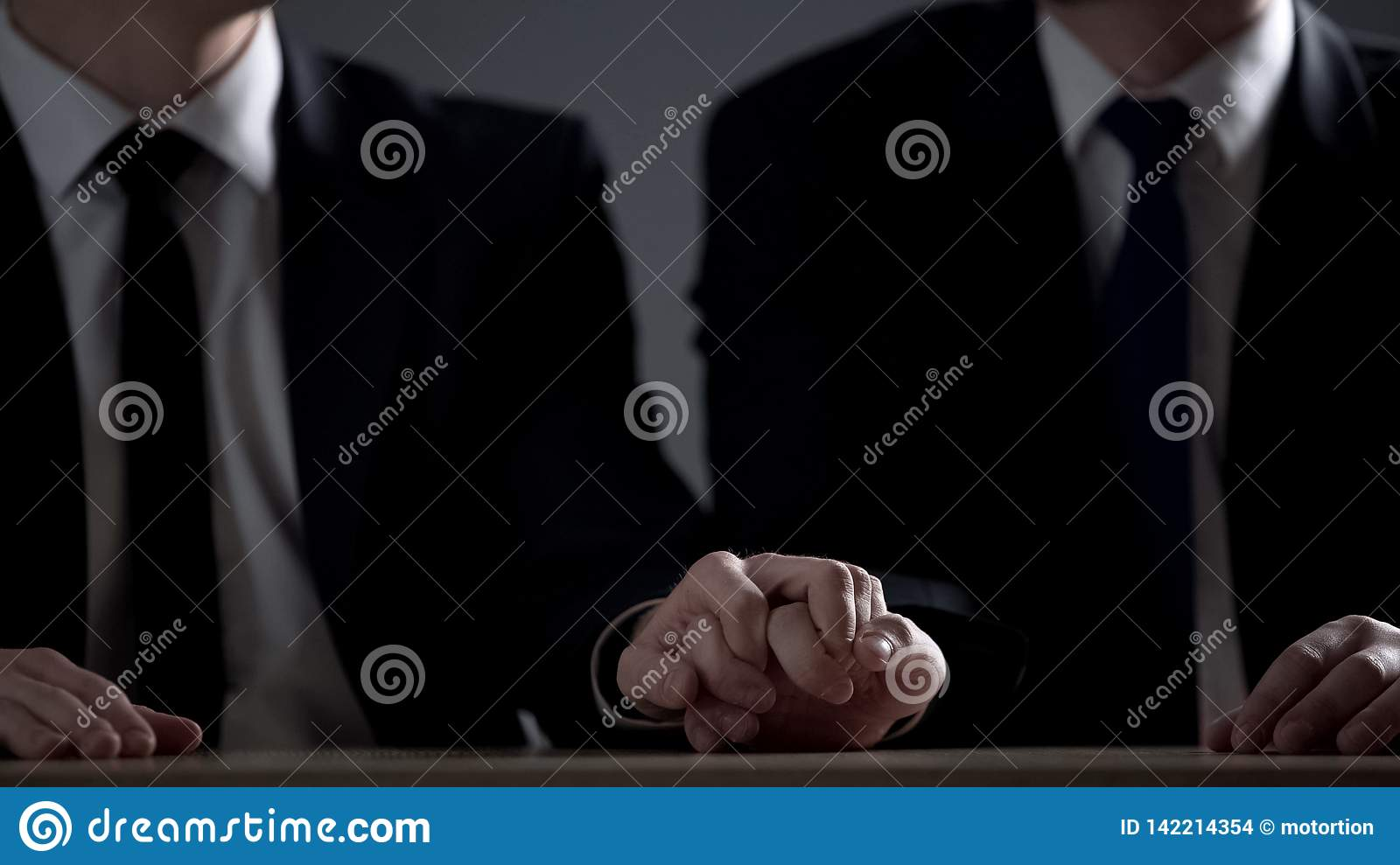 Two official men holding hands, homosexual relations for moving up career ladder