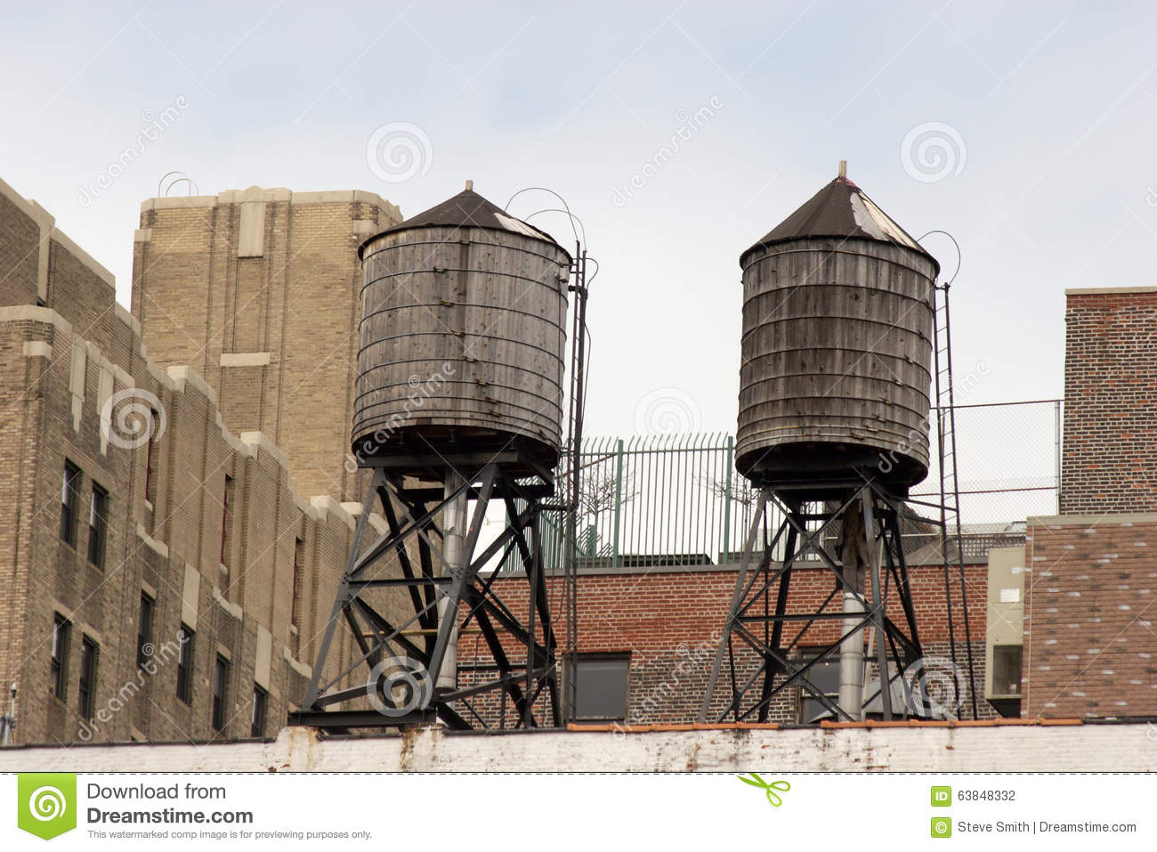 Two Old Style Wooden Water Tanks On Rooftop Greenwich