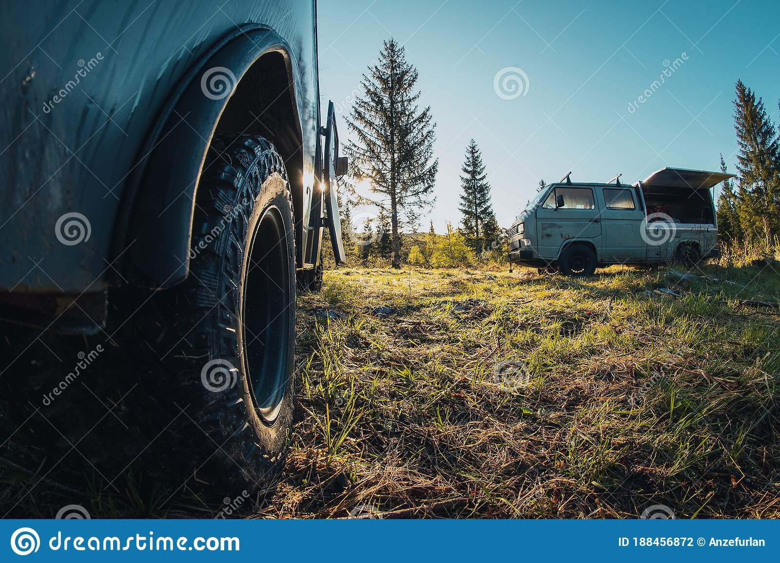 Two Old Vintage Custom Offroad Campervans Parked In The Morning Hours On The Forest Plain View Of The Serious Off Road Tire Tread Stock Photo Image Of Travel Land 188456872