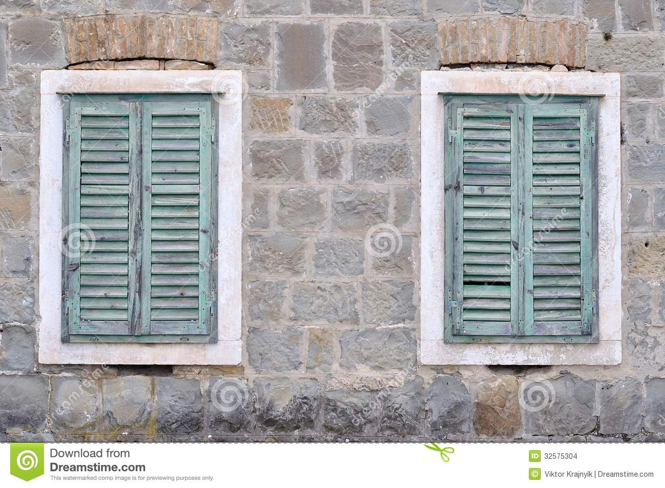 Two Old Windows With Closed Shutters On An Old House Stock
