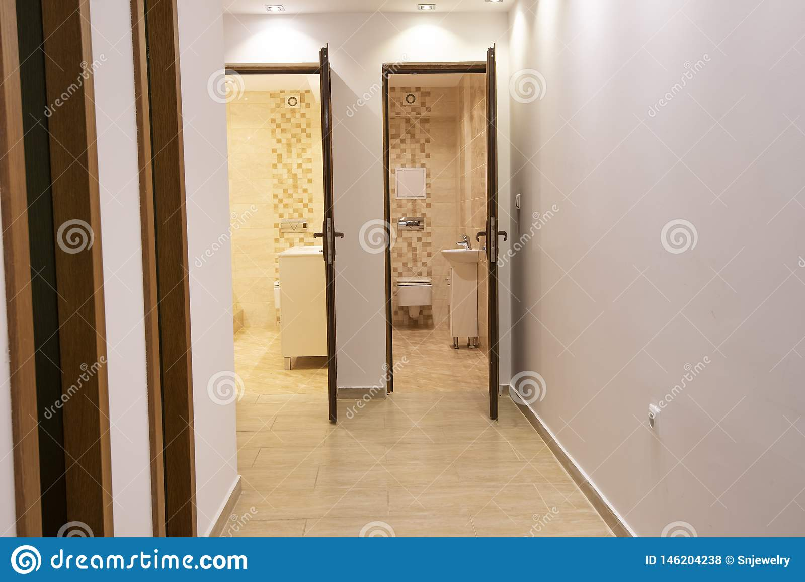 Two Open Doors To Big Modern Bathroom And Toilet Home Interior Stock Photo Image Of Handle Modern 146204238