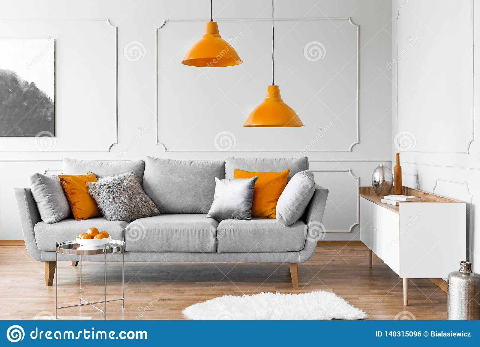 Admirable Two Orange Lamps Above Grey Scandinavian Couch With Pillows Dailytribune Chair Design For Home Dailytribuneorg
