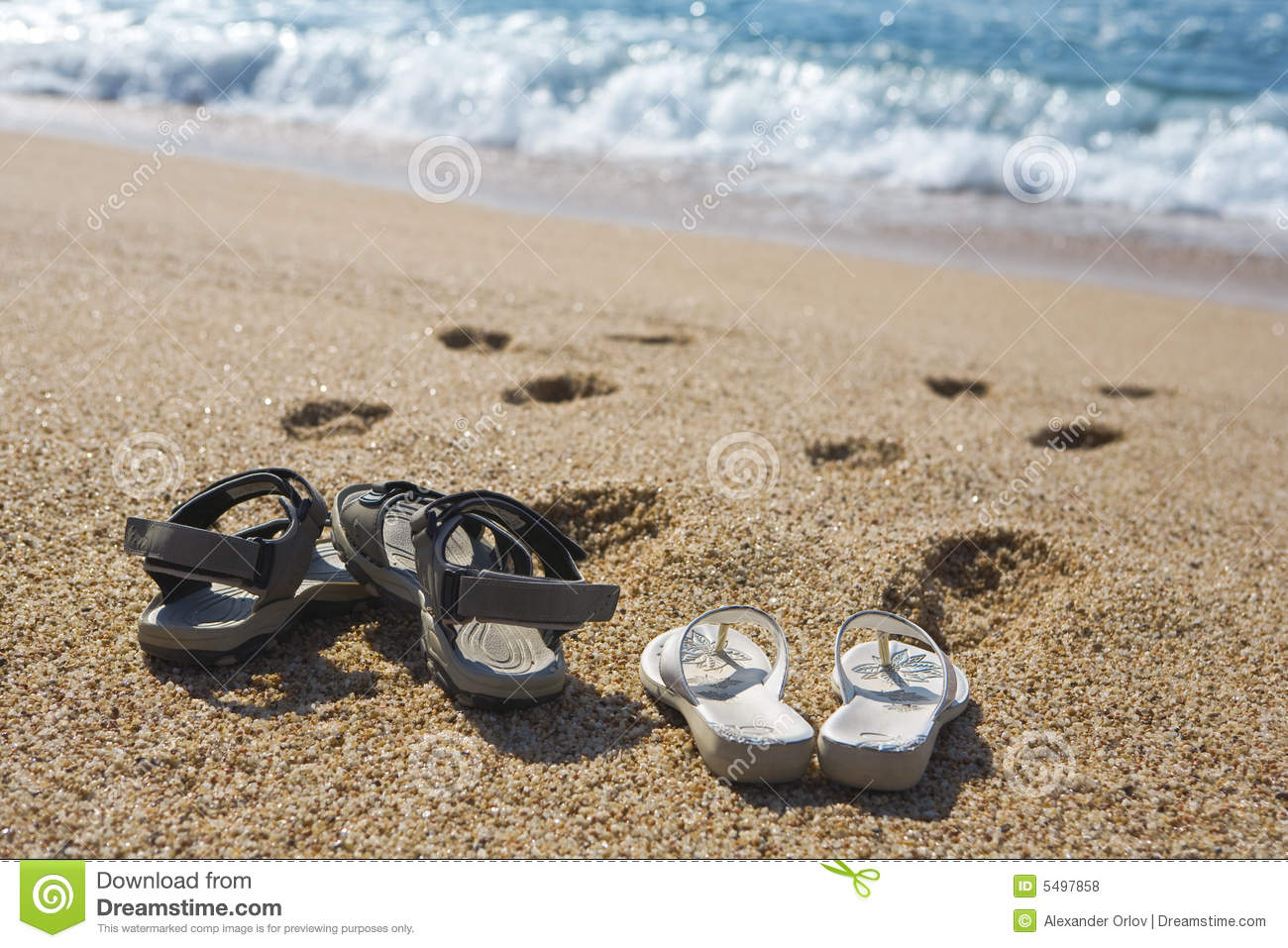 f70f20120 Two pairs of beach shoes stock photo. Image of seashore - 5497858