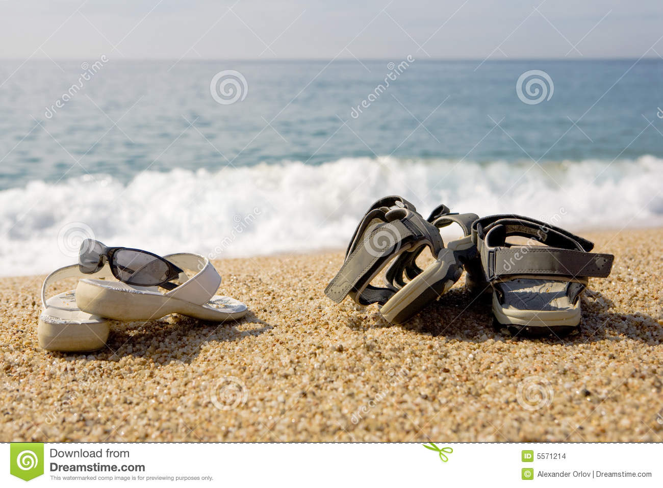 0b3267b8d A photo of two pairs of beach shoes at the seaside. More similar stock  images
