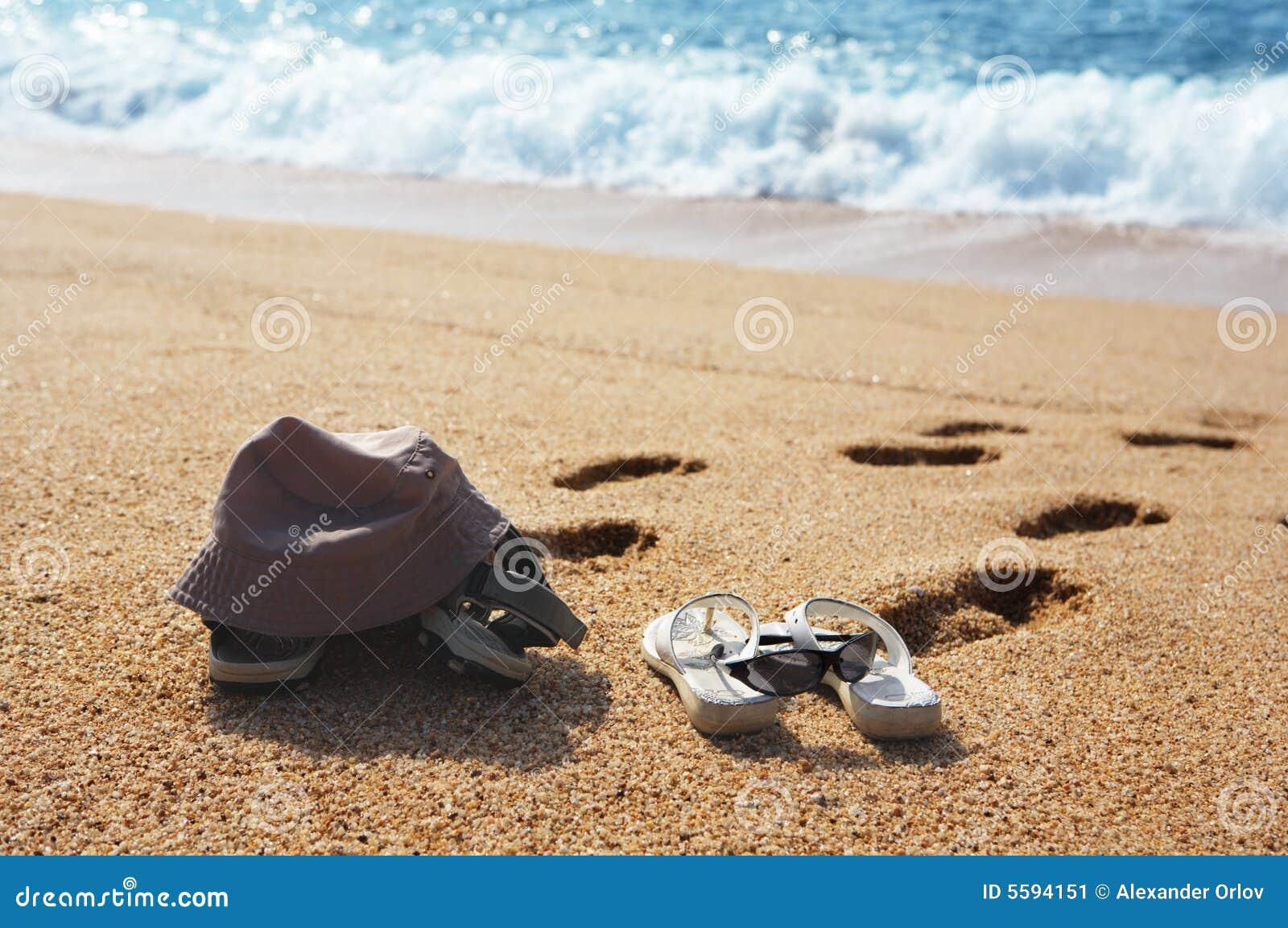 5eca37ce9 Two pairs of beach shoes stock image. Image of coastline - 5594151