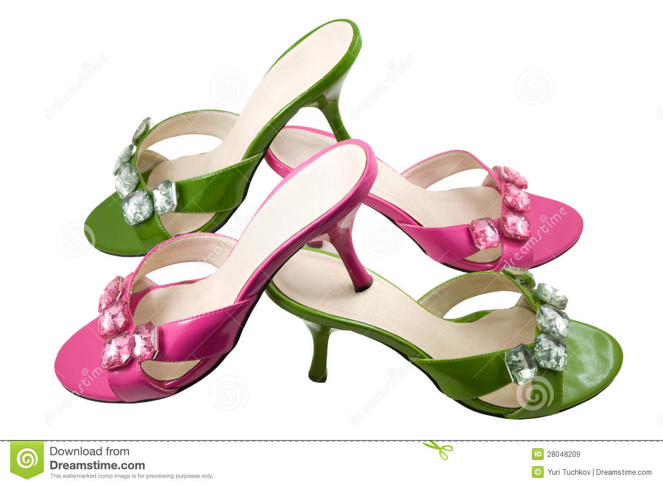 two pairs pink and green shoes royalty free stock images