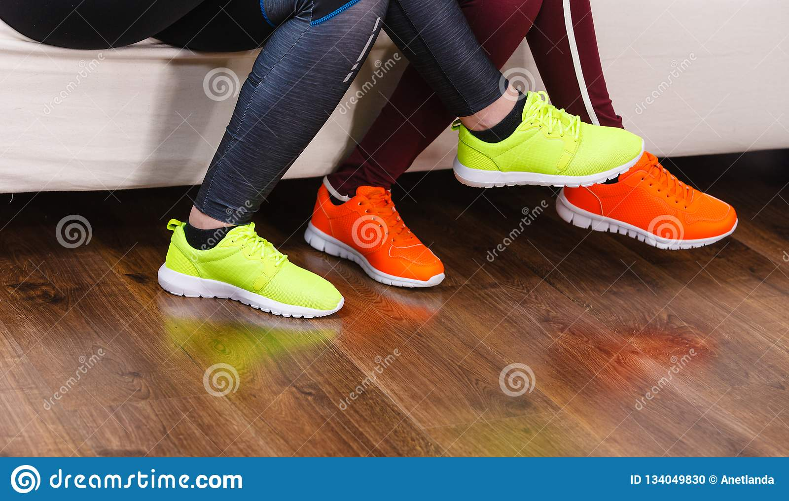 Two pairs of sport shoes stock photo. Image of boots 134049830