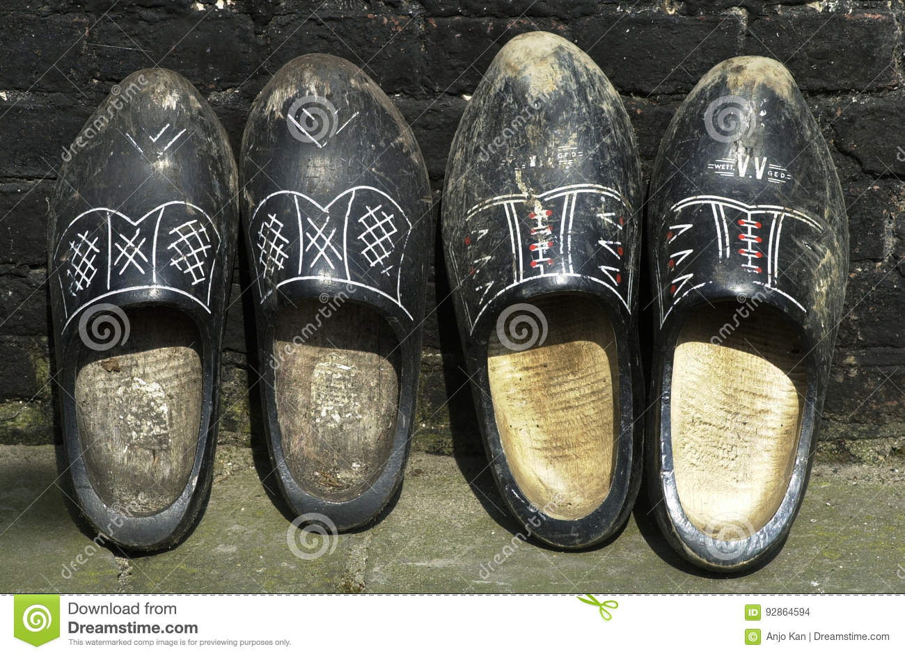 d3818ec9c12dd Two Pairs Of Vintage Wooden Clogs Stock Photo - Image of worn ...