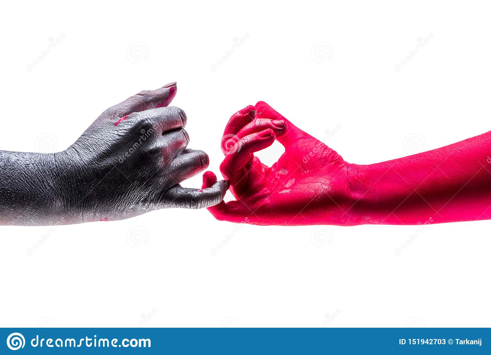 Two people carefully touch each other`s little fingers, hands colored in different colors. Concept of war and peace