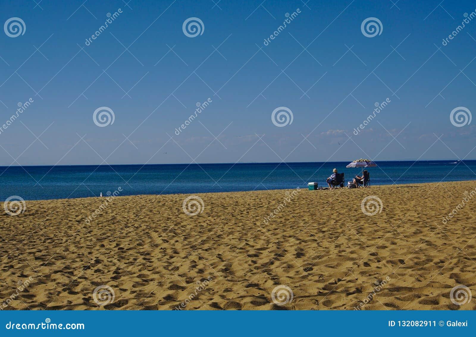 Two people enjoying sea on sunny day