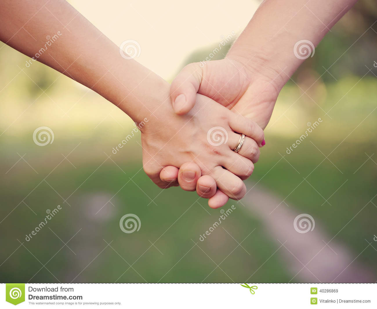 Two People Holding Hands Outdoor. Stock Photo - Image ...