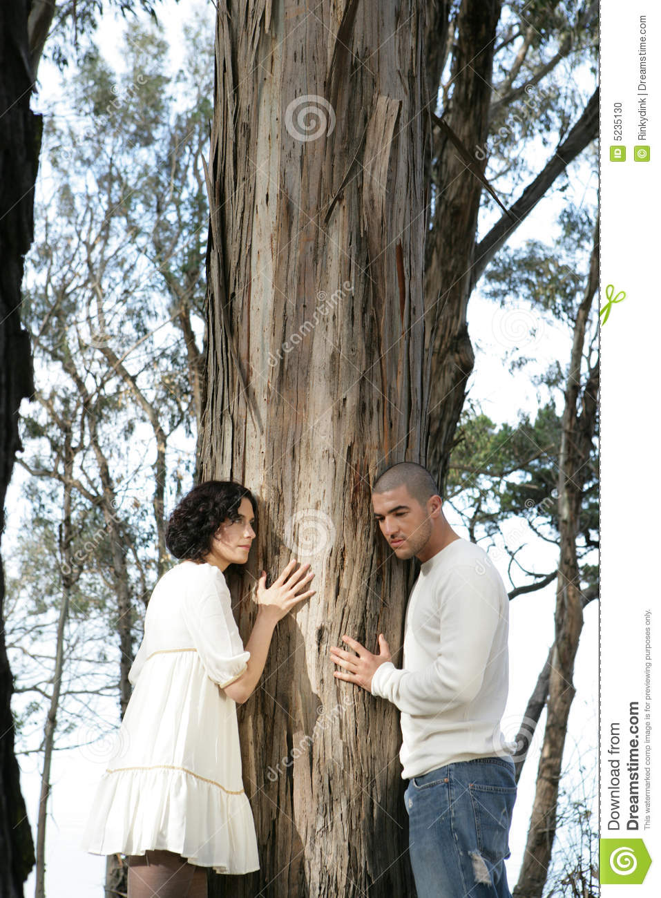 Two People Hugging A Tree Stock Photo - Image: 5235130