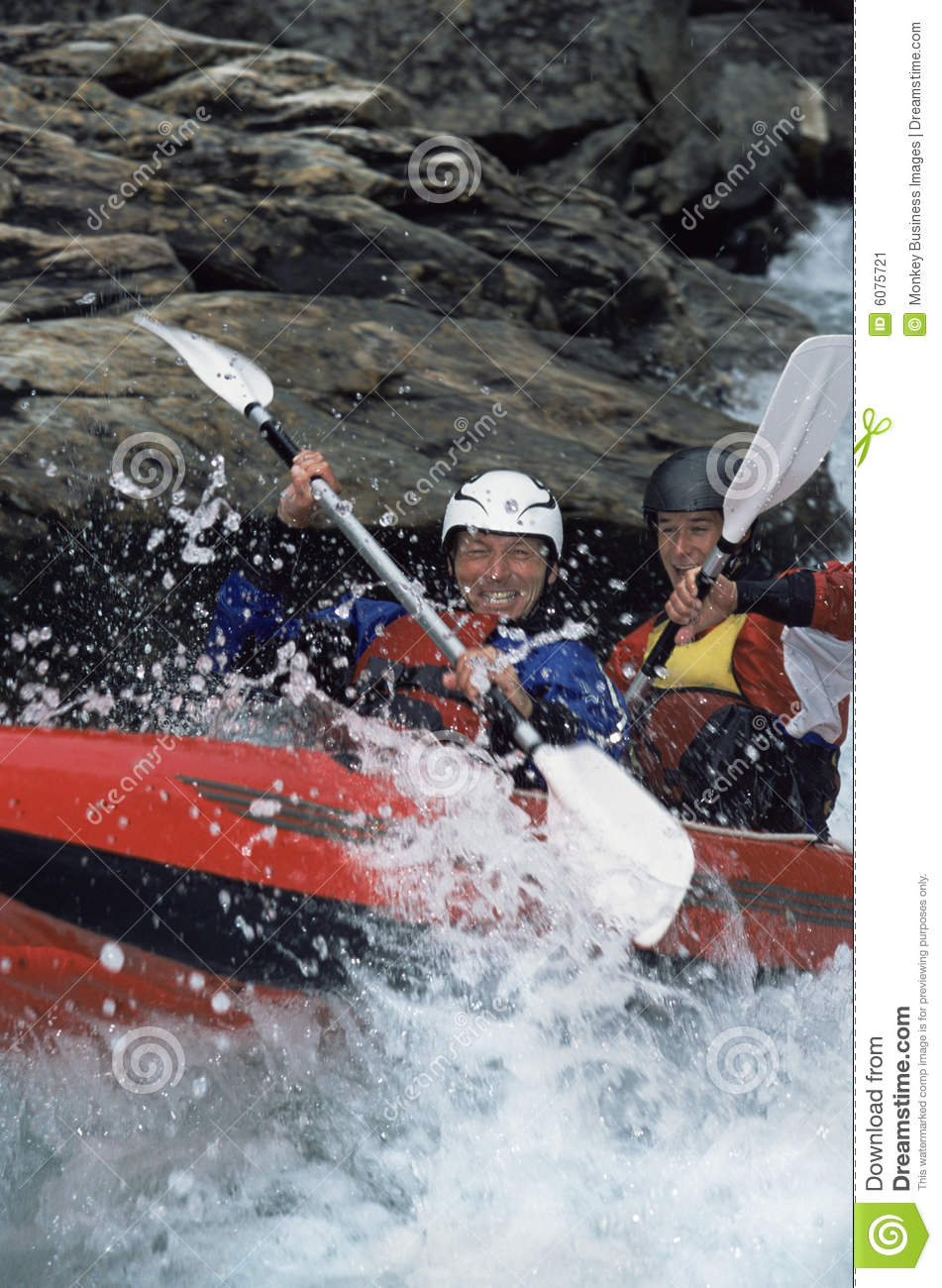 Two People Paddling Inflatable Boat Down Rapids Stock Image - Image: 6075721