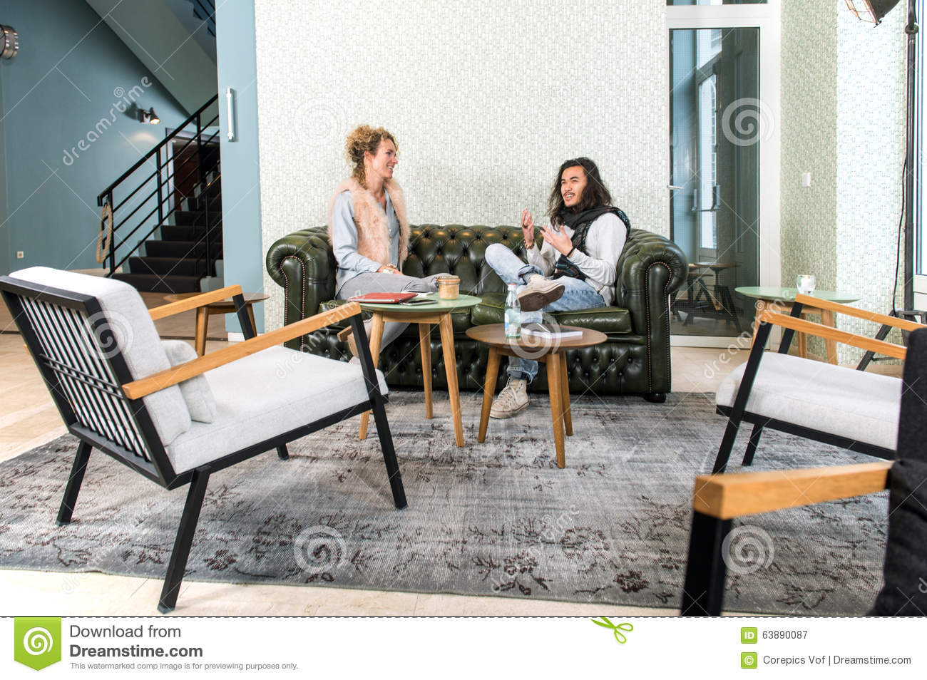 Two People Talking In A Lounge Stock Image Image Of