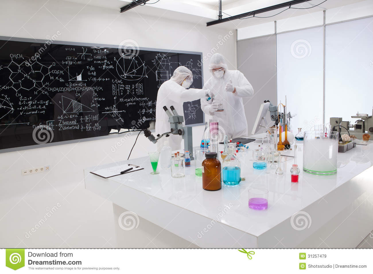 Two People Working In A Chemistry Lab Stock Image - Image of