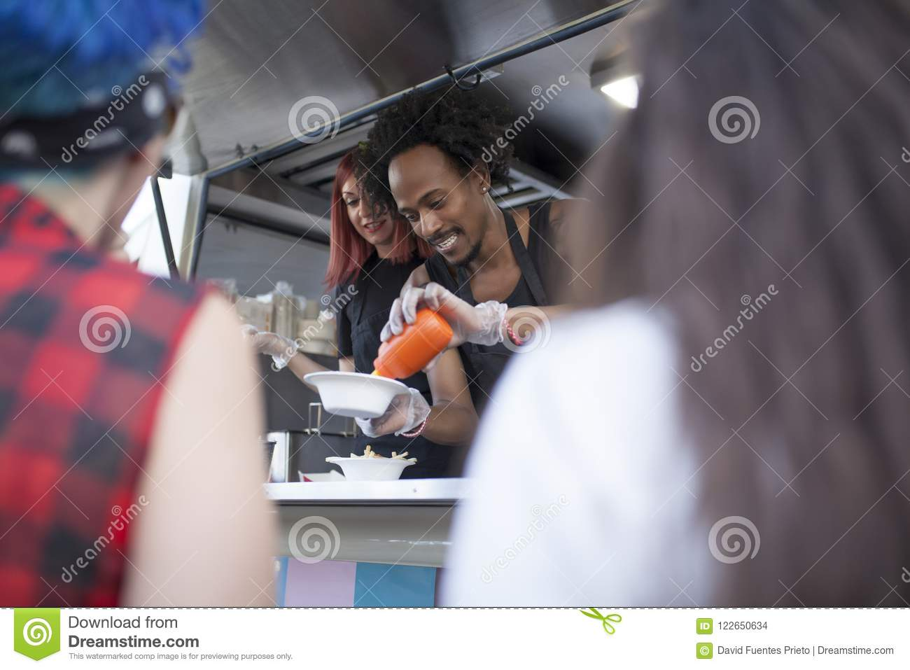 Two people works in a Food truck