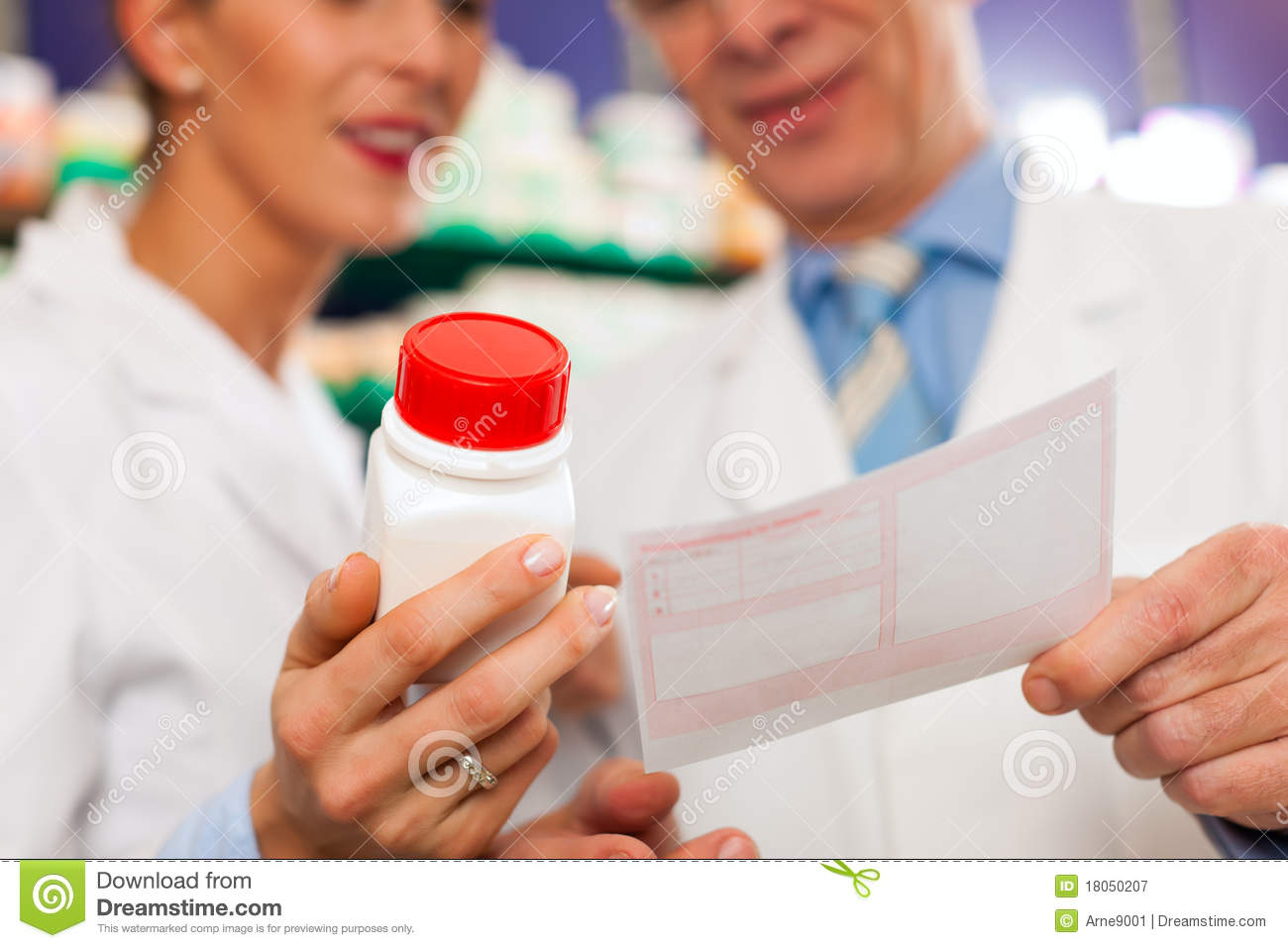 Two pharmacists in pharmacy consulting