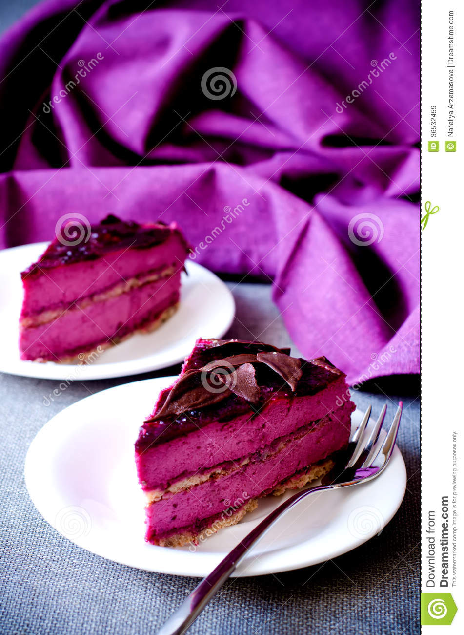 Two Pieces Of Purple Cake Souffle Black Currants Stock