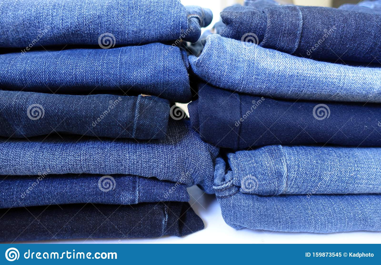 Two Piles of Denim Blue Jeans