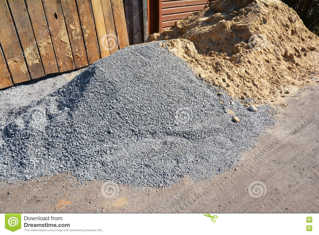 Building Sand Stone : Two piles of gravel and sand at industrial site building