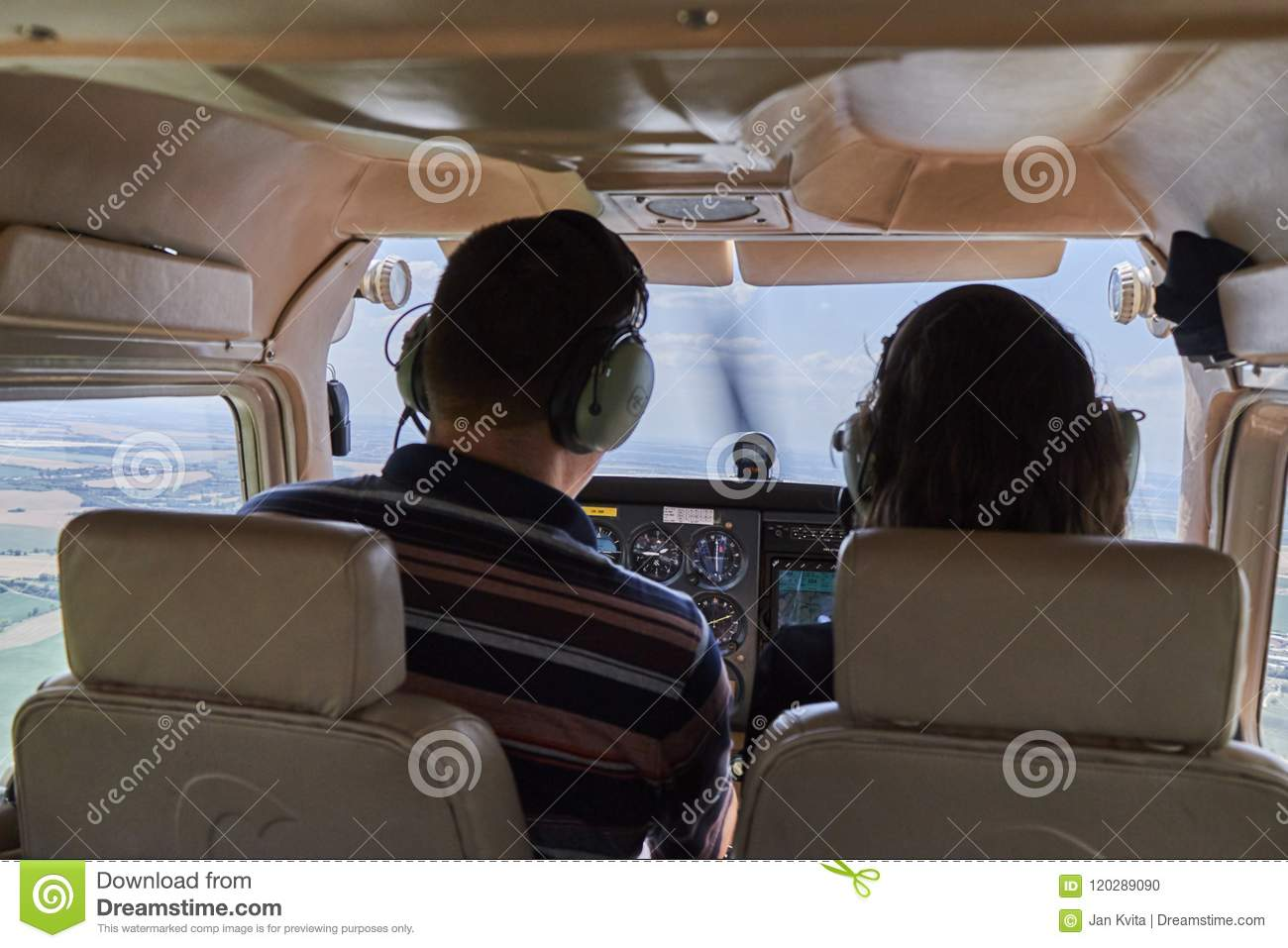 Two Pilots Sitting In A Cockpit Of Cessna Skyhawk 172 Airplane