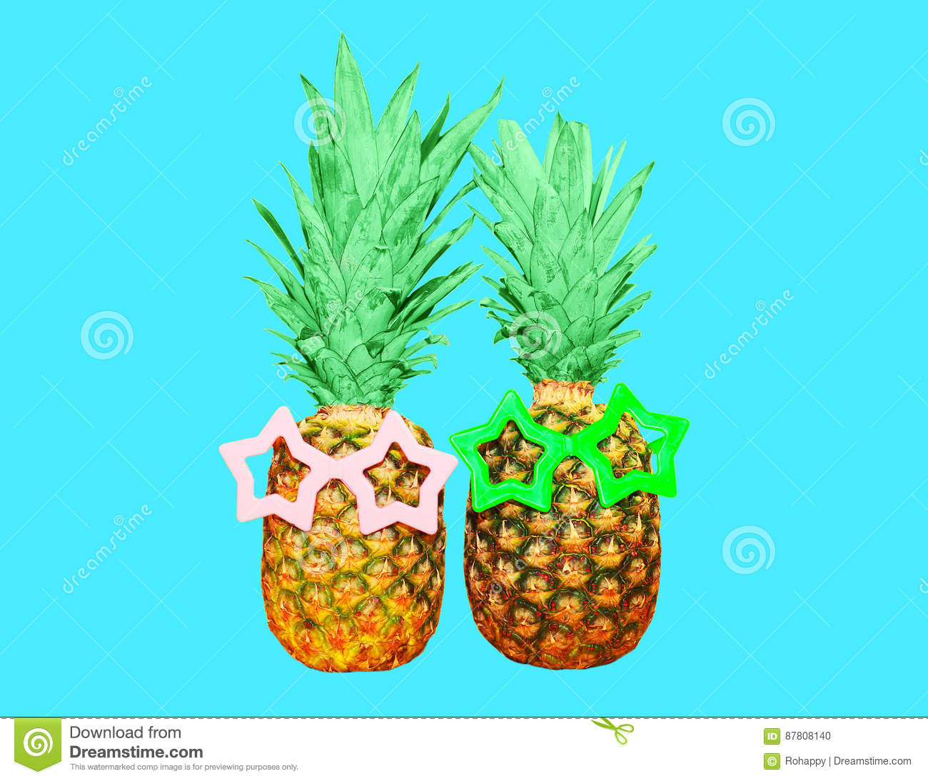 Two pineapple with sunglasses on blue background, ananas