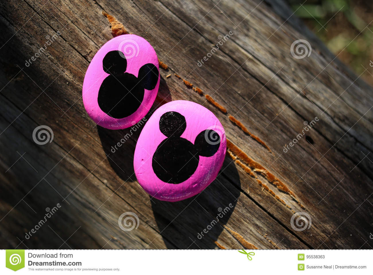 Two Pink Painted Rocks With Black Mickey Mouse Heads Stock