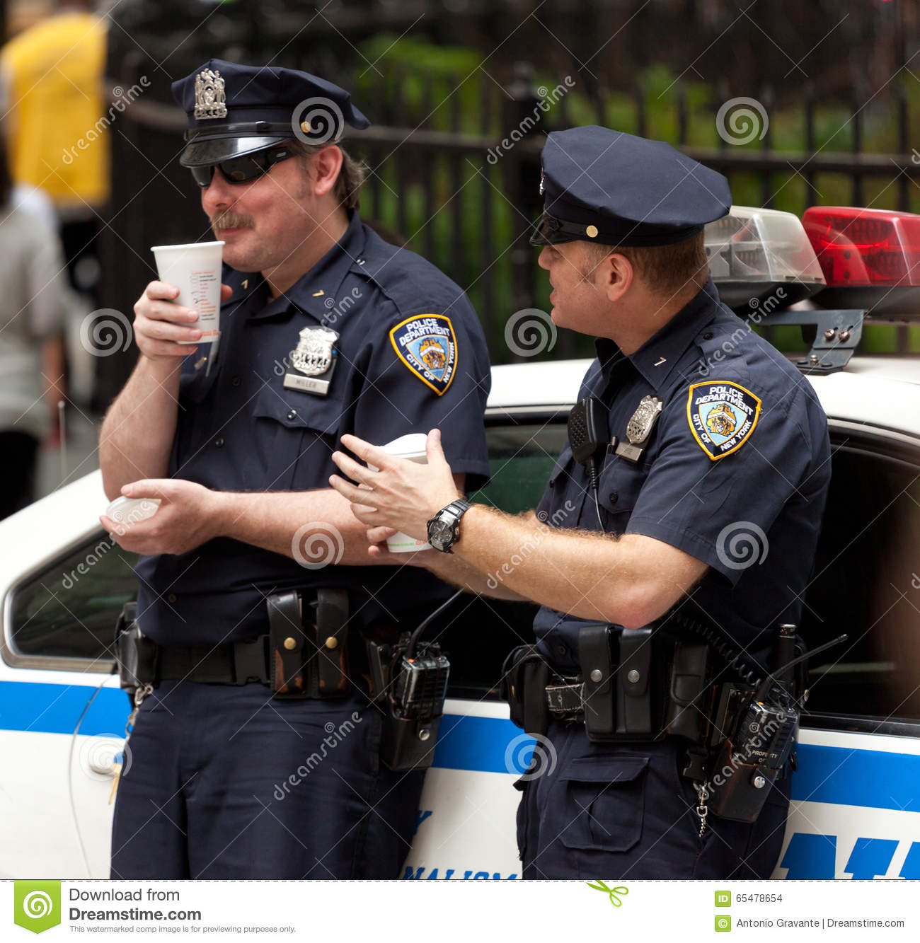 Two Police Officers While Drinking A Cup Of Coffee In Nyc