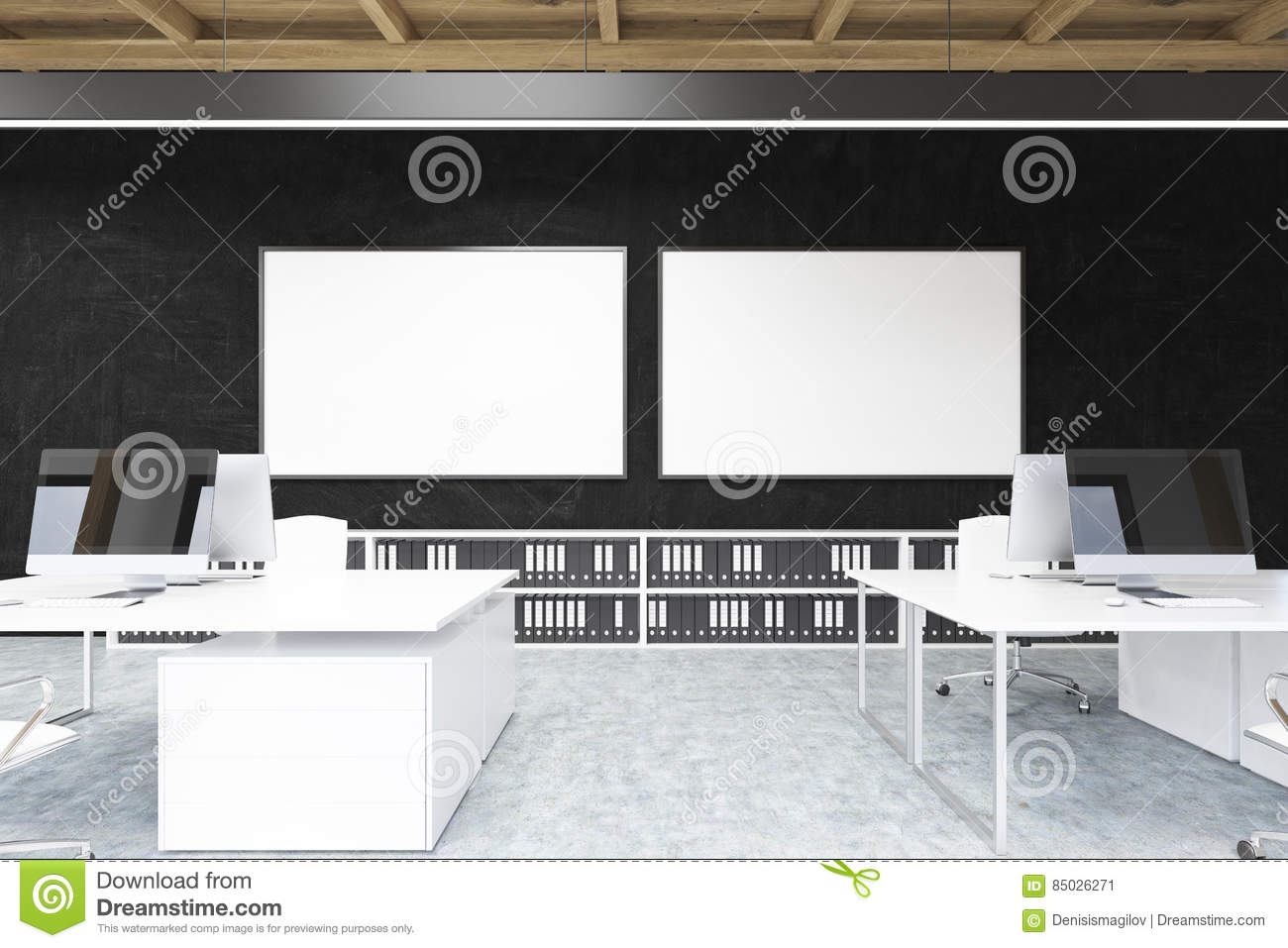 Two large horizontal posters hanging on a black office wall there are white tables with laptops on them and shelves with folders near the wall