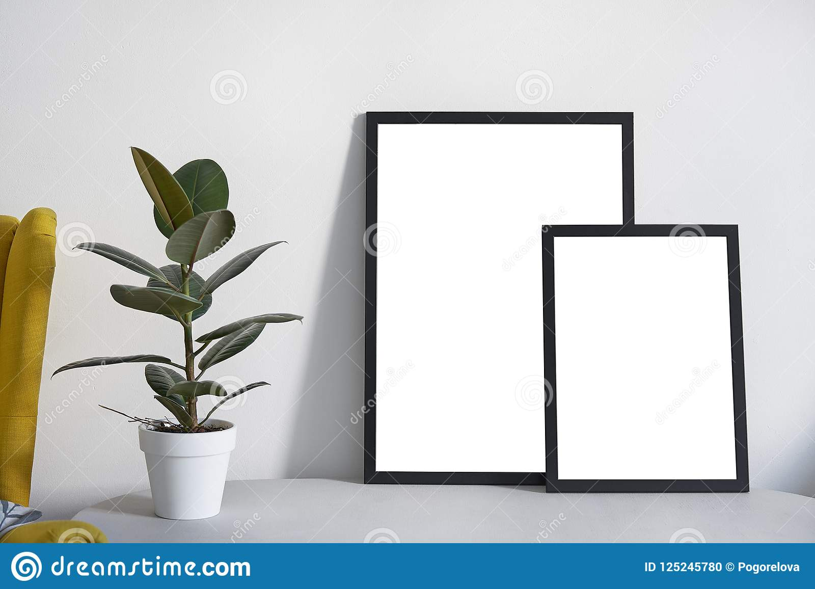 Two Posters In Different Sizes In Black Frame In Nordic