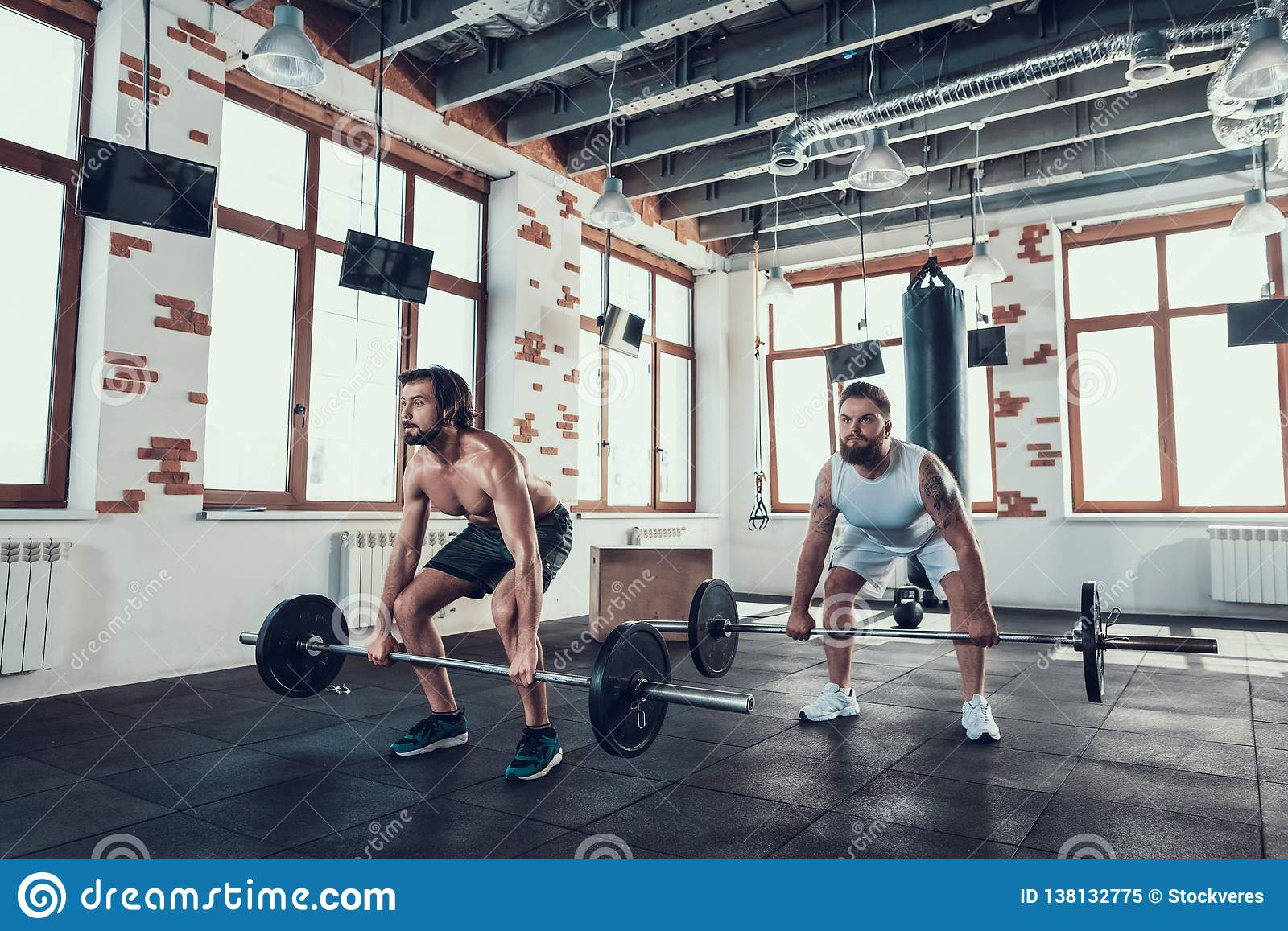 6f6ba21e84 two-powerful-guys-gym-lifting-barbells-training-day-fitness-club-healthy -lifestyle-athlete-stamina-active-holidays-crossfit-138132775.jpg