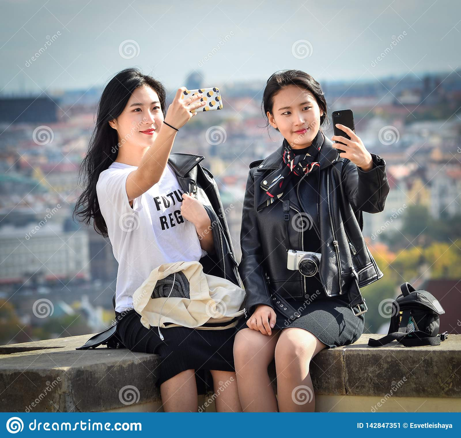 Two Pretty Asian Girls Taking Selfie And Looks At The Old
