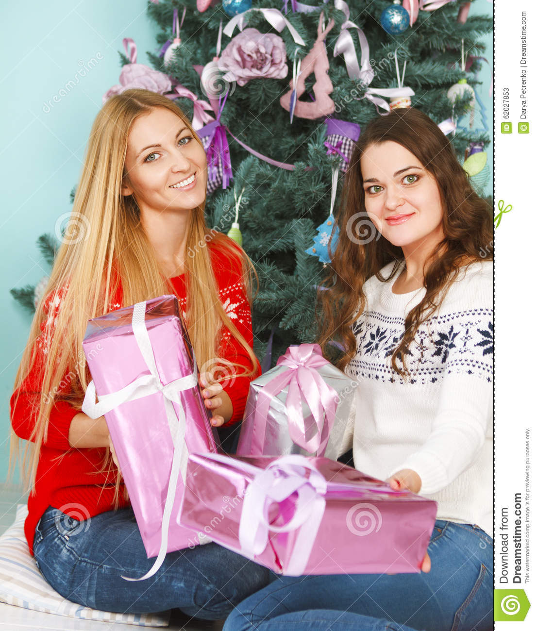 Two Pretty Best Friends Girls Opening Christmas Presents Near Th ...