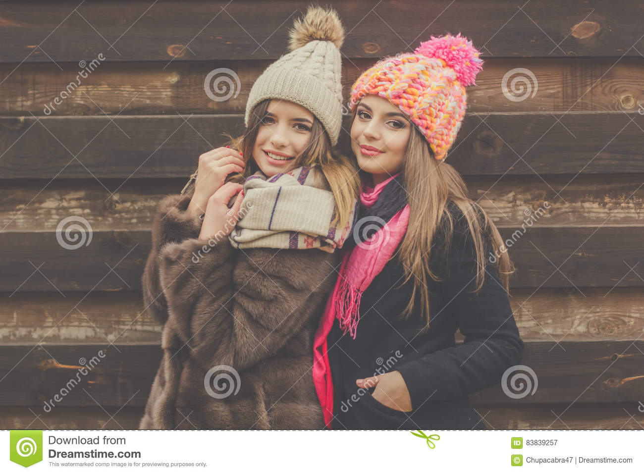 d201623fc Two Pretty Girl Are Wearing Warm Winter Clothes Stock Image - Image ...