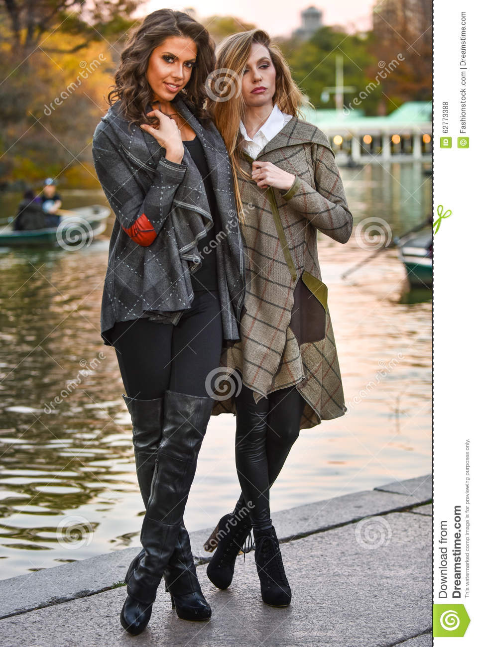 Two Pretty Girls In Elegant Coats Posing In Autumn Park. Stock