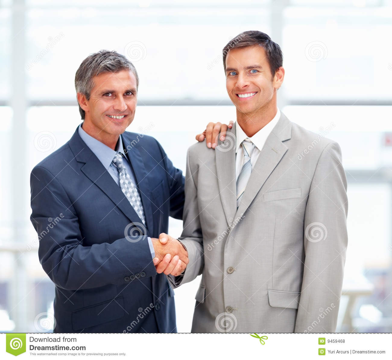 two professional business men greeting eachother stock