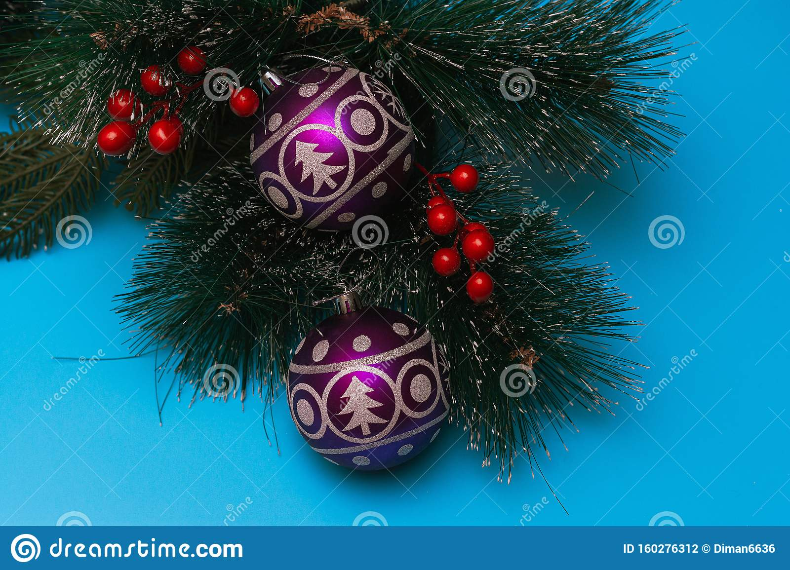 Two Purple Festive Balloons With The Image Of A Christmas Tree And Snowflakes Lie On Artificial Branches Of A Spruce Blue Stock Photo Image Of Detail Collection 160276312