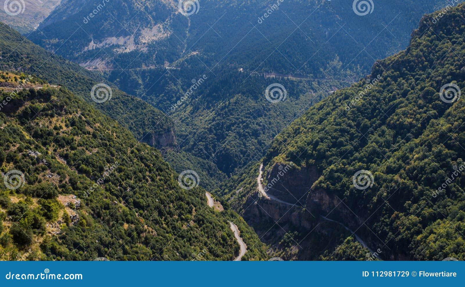 Two rads in mountain in National Park of Tzoumerka, Greece Epirus region. Mountain