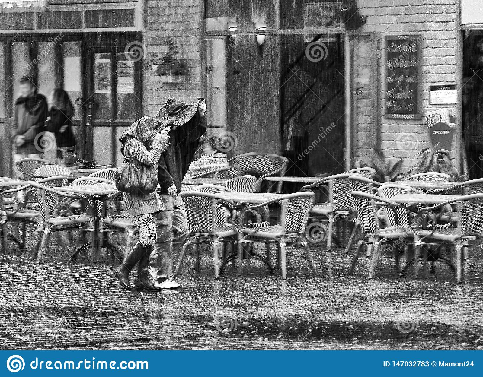 Two in the rain. B & W.