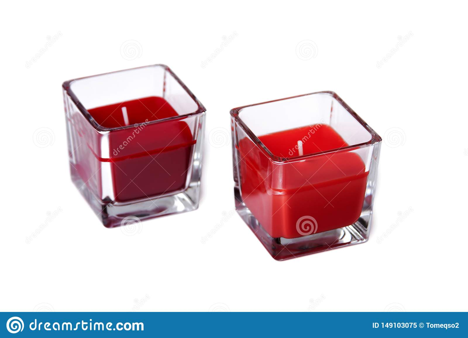 Two red glass candles, a pair of colourful tea lights isolated on white