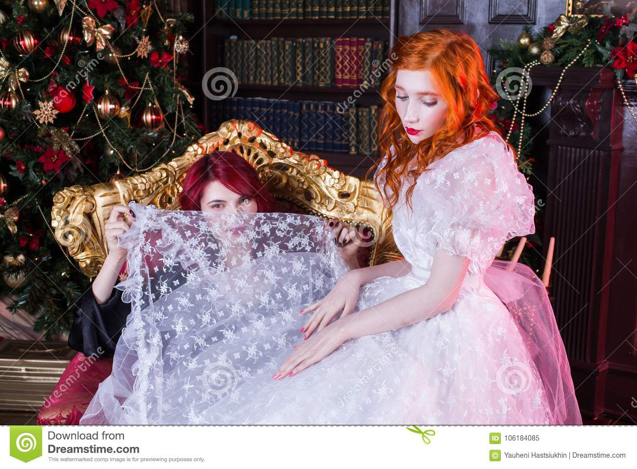 Two Beautiful Girls With Red Hair In A Beautiful White Wedding