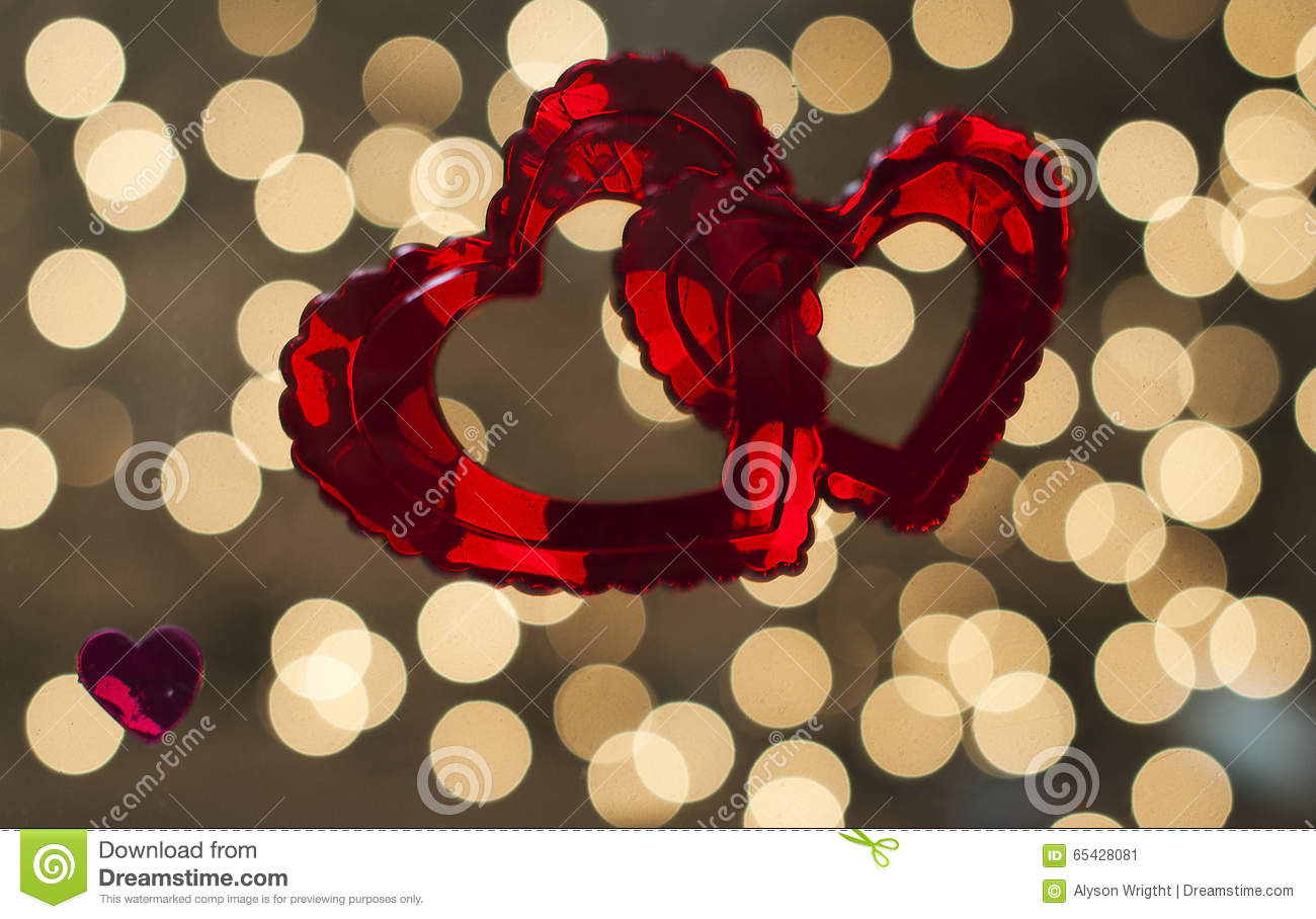 Two Red Hearts Are Intertwined And Set Against A ...