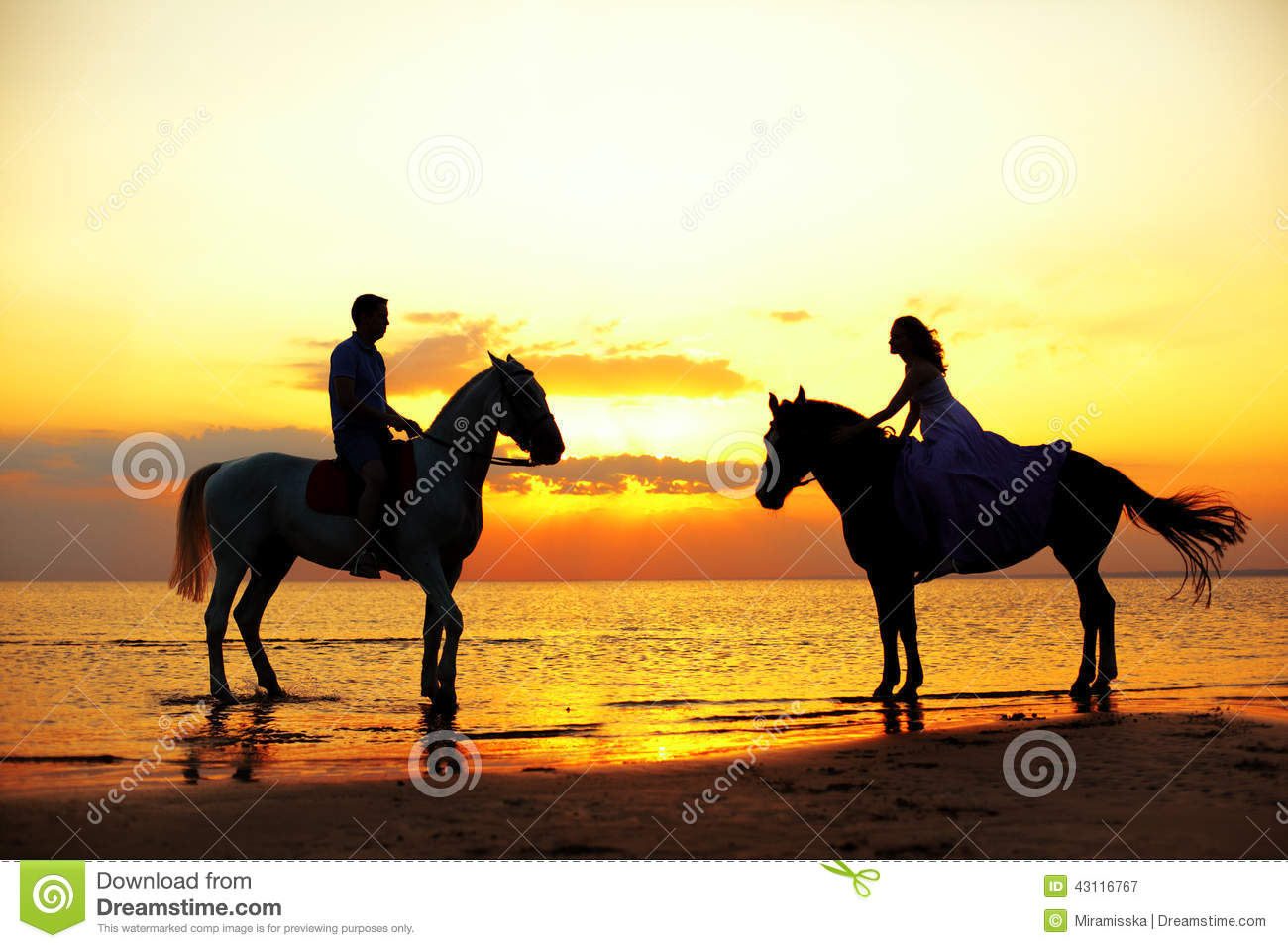 Two Riders On Horseback At Sunset On The Beach. Lovers Ride Hors Stock ...