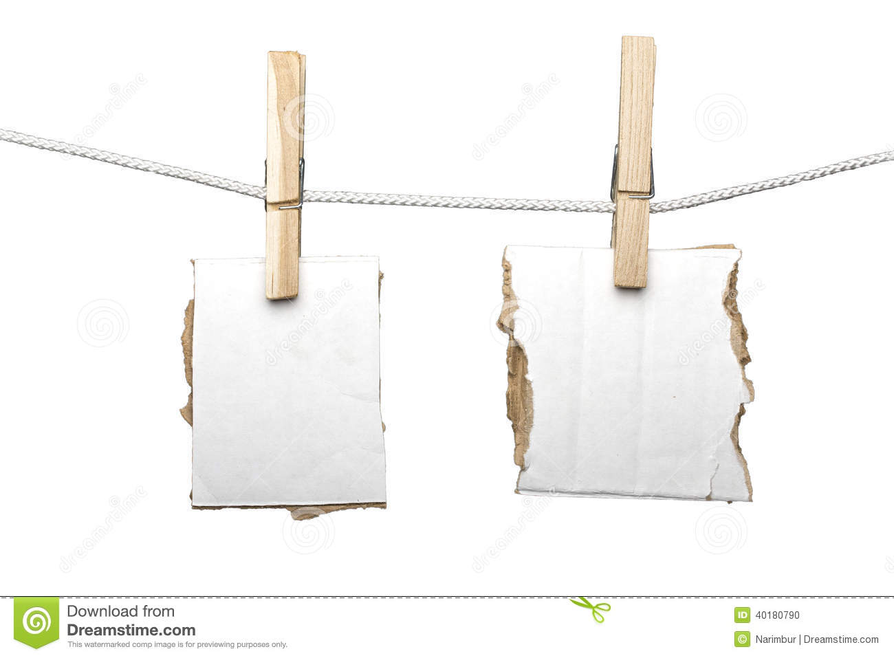 two ripped pieces of card board hanging on one clothespins