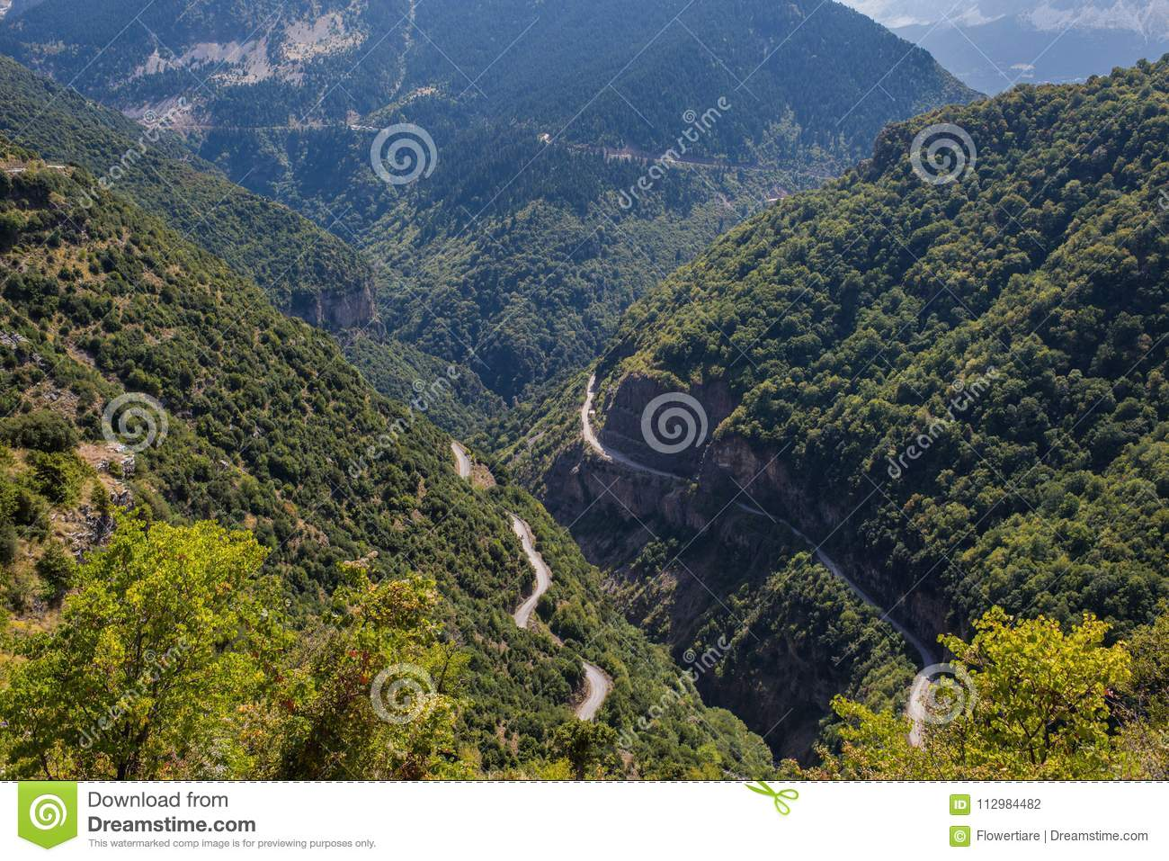 Two roads in the mountain in National Park of Tzoumerka, Greece Epirus region. Mountain in the clouds