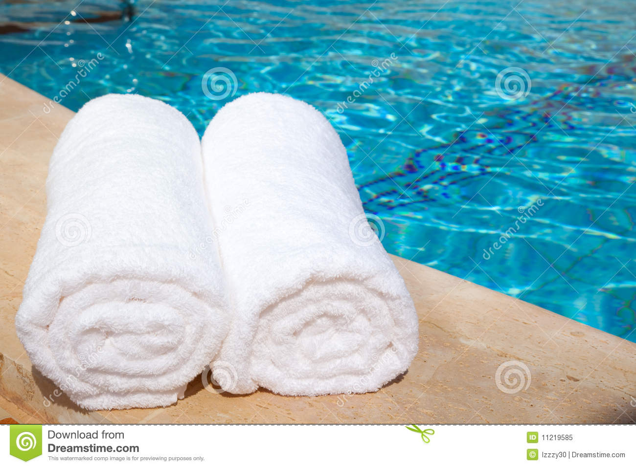 Two rolled up white towels by blue pool stock image for How to get towels white