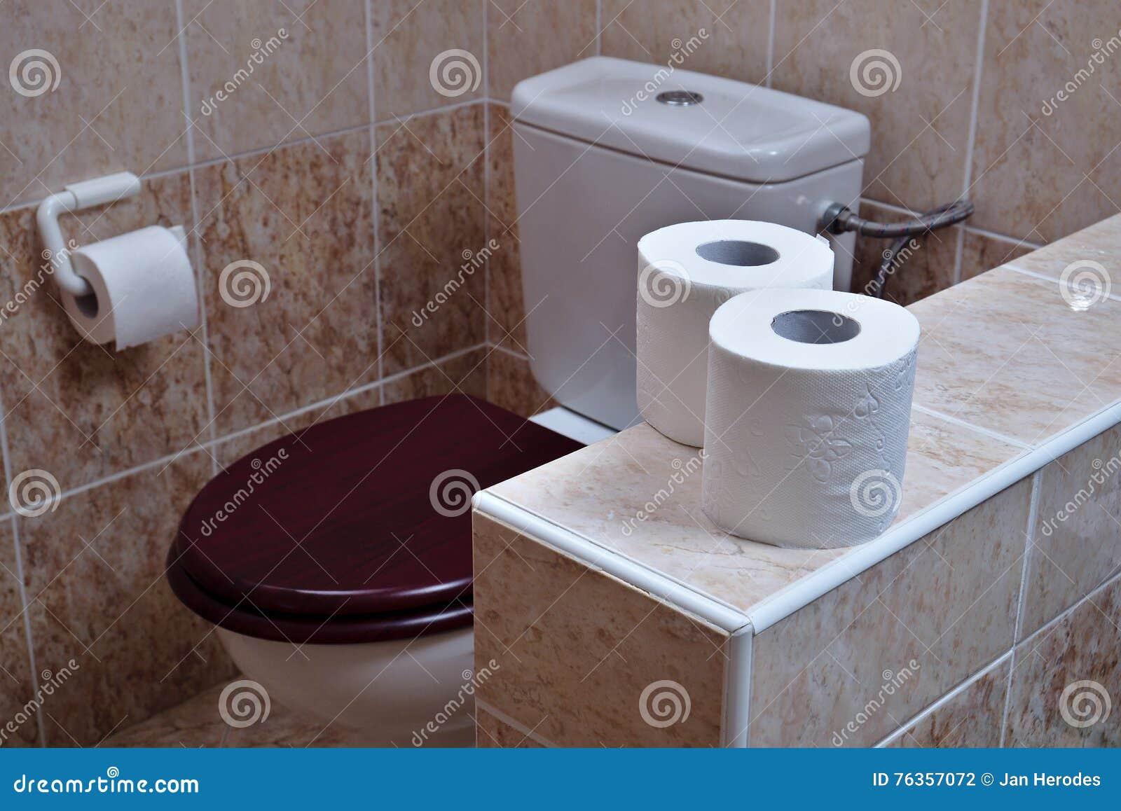 Enjoyable Two Rolls Of White Toilet Paper In The Background Toilet Inzonedesignstudio Interior Chair Design Inzonedesignstudiocom
