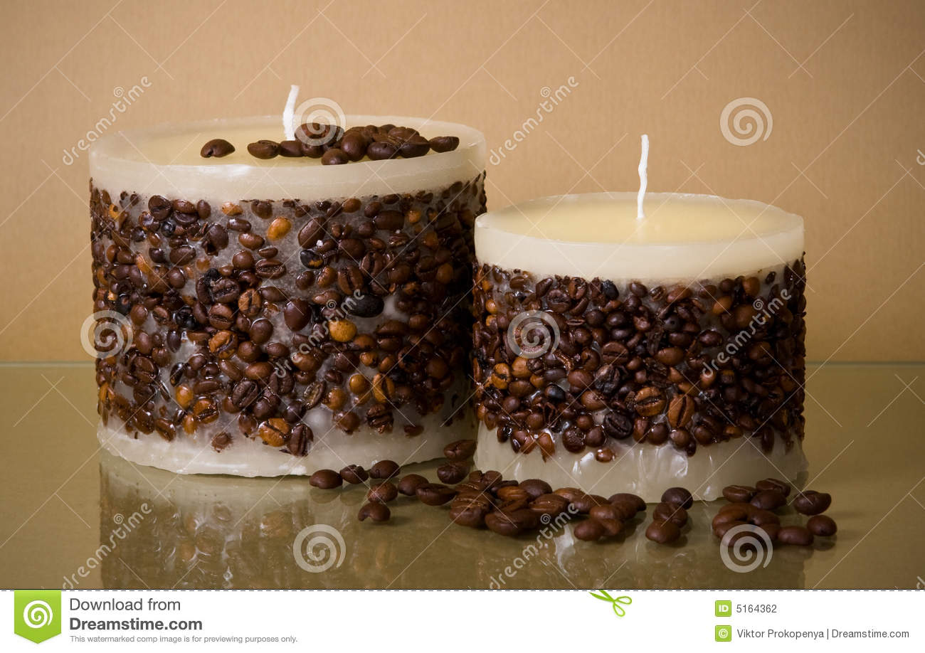 Two Round Coffee Candles And Coffee Beans On Brown Stock