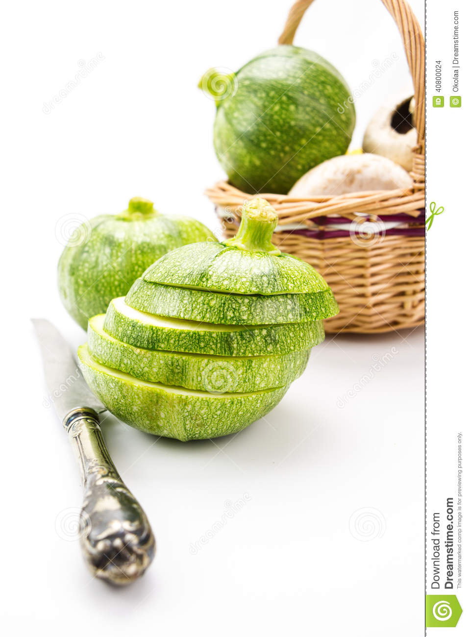 Two Round Zucchini Cut In Slices And Wicker Basket With ...